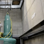 Water management consultants in a new wastewater collection and transport pumping station